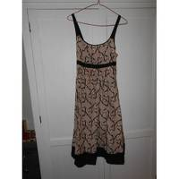 Maje mini dres with Elasticated back and knot tie. Angle2