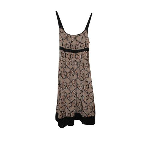 Maje mini dres with Elasticated back and knot tie.