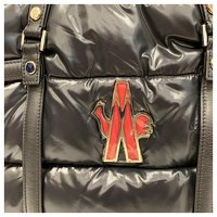 Moncler, Black padded and quilted nylon travel bag Angle3