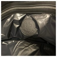 Moncler, Black padded and quilted nylon travel bag Angle6