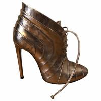 Alaia lace up metallic leather booties