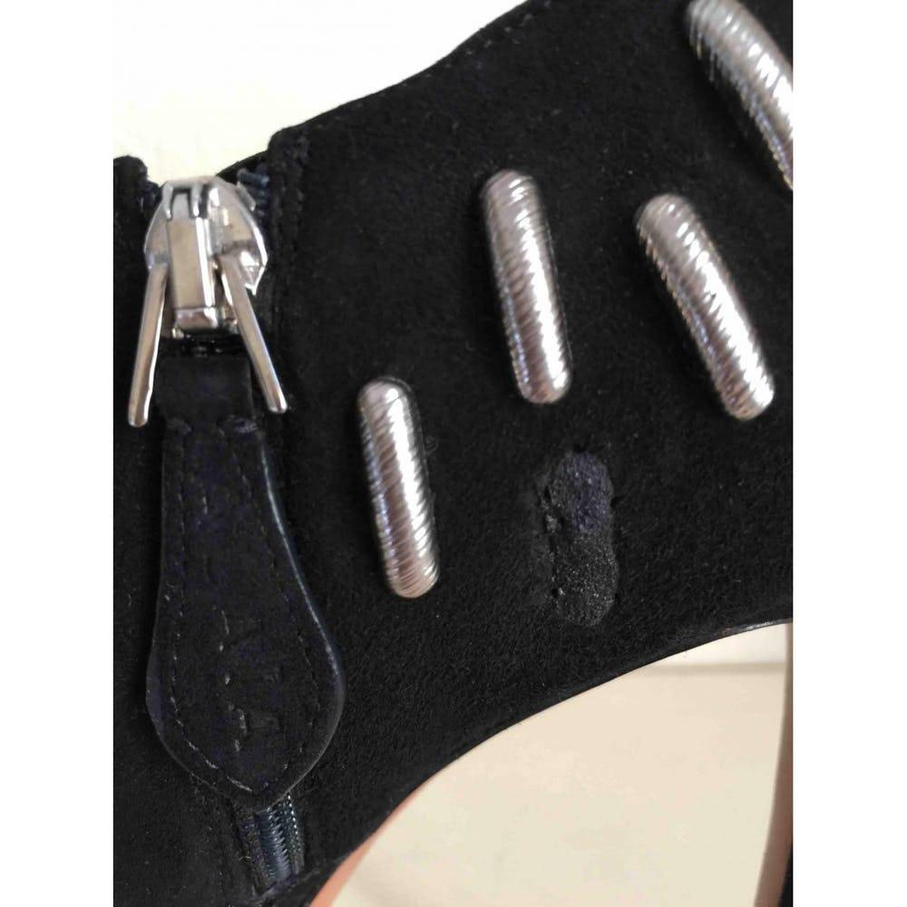 Alaia ankle booties with studs